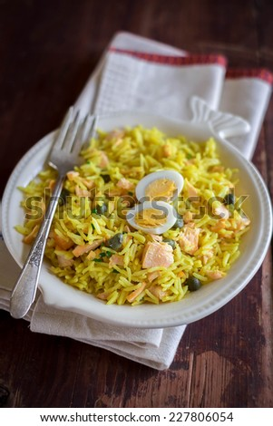 National scottish dish kedgeree with roasted basmati rice, curry powder and fish in a plate - stock photo