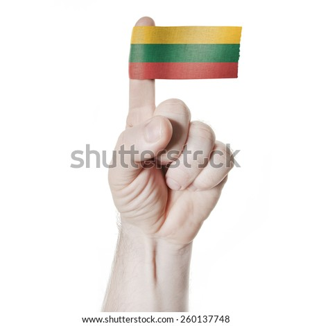 National symbol: the hand and index finger with the flag of Lithuania - stock photo