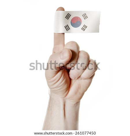 National symbol: the hand and index finger with the flag of South Korea - stock photo