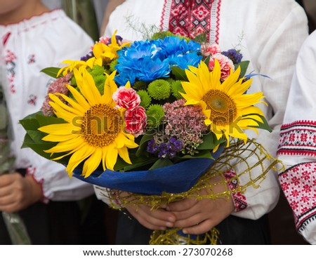 National traditions. Flowers in the hands of a child. Ukraine. - stock photo