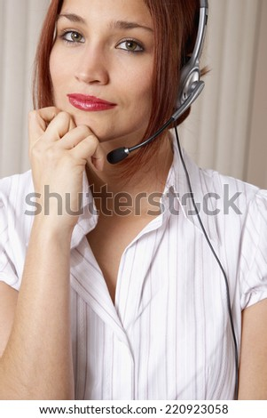 Native American businesswoman wearing headset - stock photo