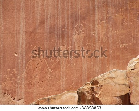 Native American drawings on canyon wall - stock photo