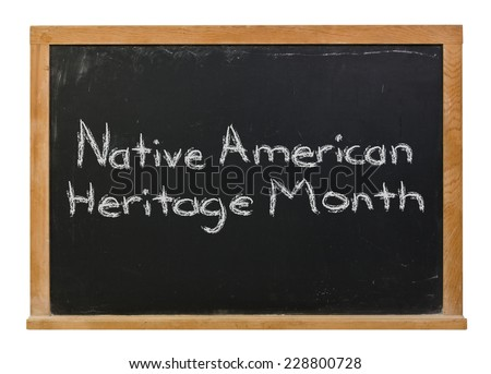 Native American Heritage Month written in white chalk on a black chalkboard isolated on white - stock photo