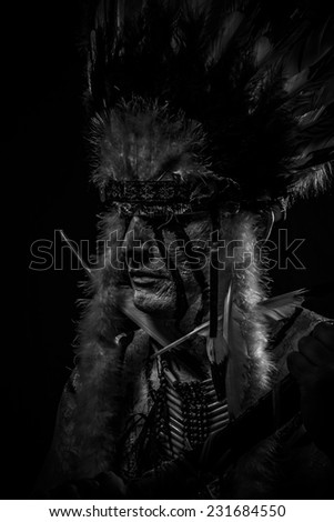 Native, American Indian chief with big feather headdress - stock photo