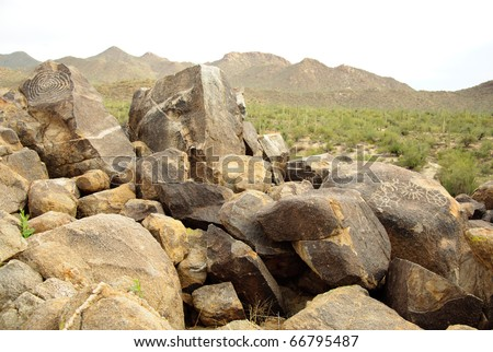 native american indian petroglyphs and hills of cacti - stock photo