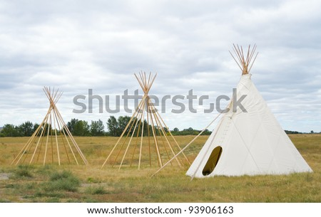 Native American Indian teepees in a field - stock photo