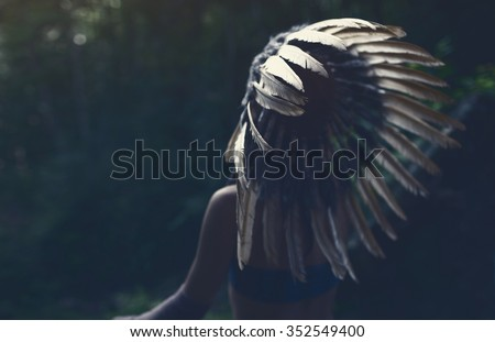 Native american, Indian woman in traditional dress,posing in the wild forest - stock photo