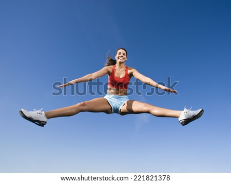 Native American woman jumping in mid-air - stock photo