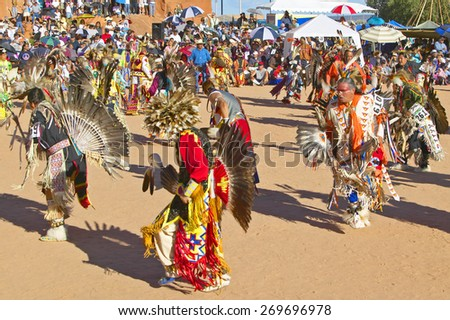 Native Americans in full regalia dancing at Pow wow - stock photo