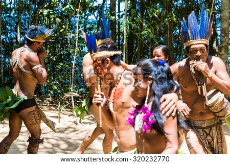 Native Brazilian people dancing at an indigenous tribe in the Amazon - stock photo