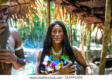 Native Brazilian woman at an indigenous tribe in the Amazon - stock photo