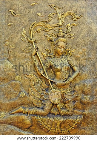 Native culture Thai sculpture on the temple wall - stock photo