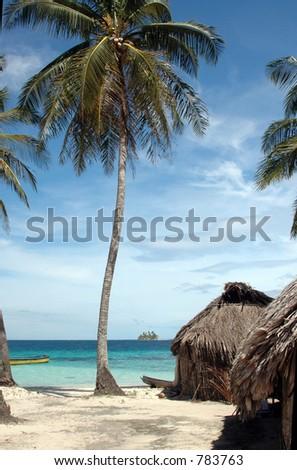 native hut with two boats placid beach panama  San Blas Island of the Kuna Indians Caribbean Sea Panama Central America - stock photo