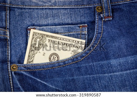Native jean pocket with dollar money.