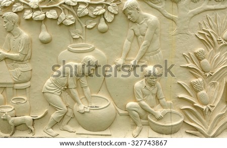 Native Thai culture stone carving on temple wall