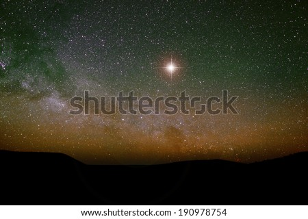 Nativity scene backdrop with the Christmas star and the real night sky. - stock photo