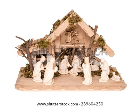Nativity Scene made of wood and stone, isolated on white - stock photo