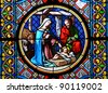 Nativity Scene. Stained glass window in the Cathedral of Basel, Switzerland - stock photo
