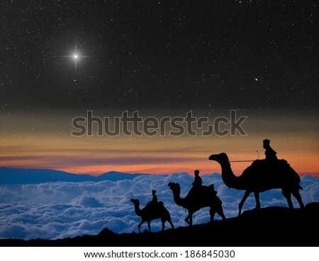 Nativity scene: The 3 wise men follow the Christmas star over the mountains. - stock photo