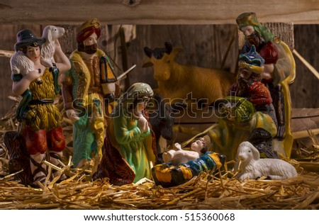 nativity scene with hand-colored figures made out of wood. Focus on  Mary!