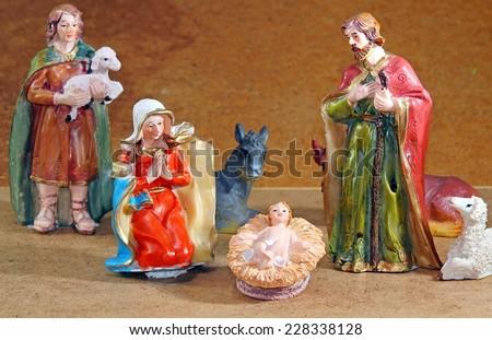 Nativity scene with Mary and Joseph and the baby Jesus near Shepherd - stock photo