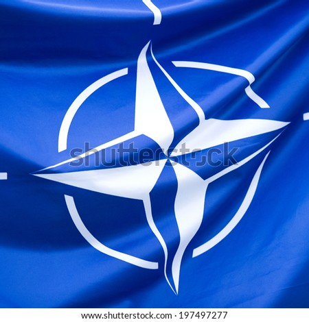 NATO Flag - Close-up photo of waving original and simple NATO flag. NATO is an intergovernmental military alliance based on the North Atlantic Treaty which was signed on 4 April 1949.