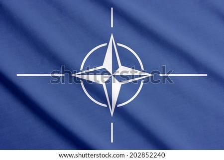 NATO flag waving - stock photo