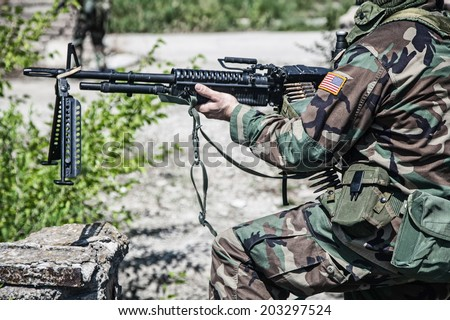 NATO soldier with machine gun during the military operation