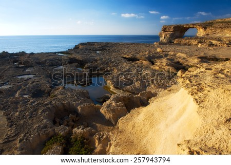 Natral limestone arch at the Maltese island Gozo - stock photo