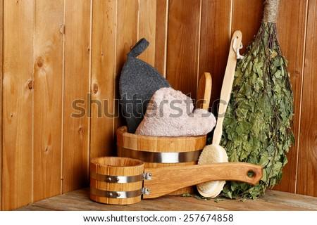 Natural accessories in sauna - stock photo