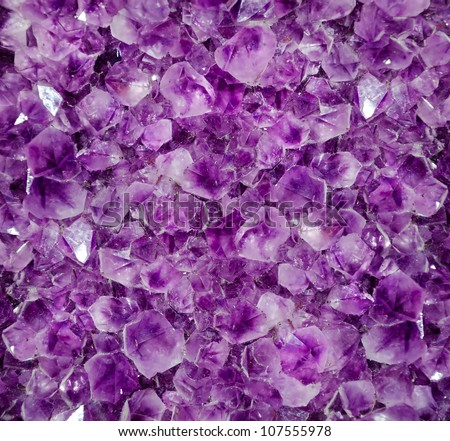 Natural amethyst crystal background. Amethyst is a violet variety of quartz - stock photo