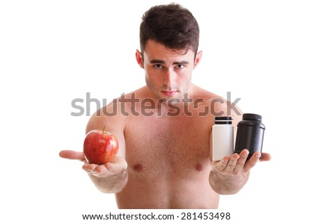 natural apple vitamin or pill drag tablet. Man isolated offering pill in one and pills in bottle - in another hand boxes with supplements