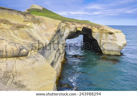 Natural arch at Tunnel beach, Otago Peninsula, New Zealand - stock photo