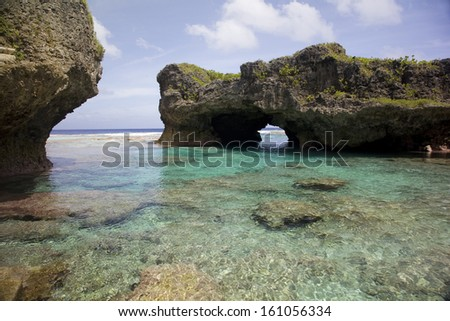 Natural arch over one of the Limu pools, Niue, South Pacific. - stock photo