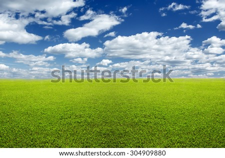 Natural background: flat green lawn and sky - stock photo