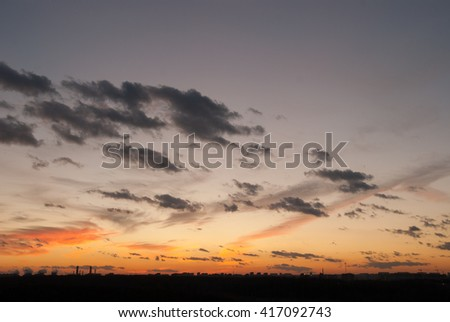 Natural background of  colorful red sky during  sunset time with street roofs