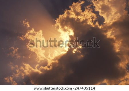Natural background with the sunset sun  sky and clouds - stock photo