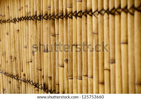 Natural bamboo fence with shallow depth of field - stock photo