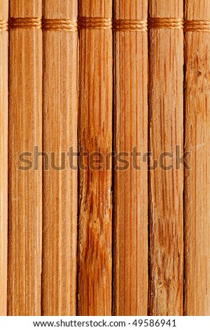 natural bamboo slatted mat background in brown tones