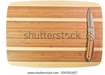 Natural bamboo surface with sharp steel knife on top