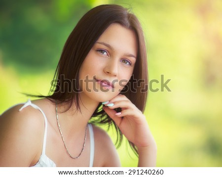 Natural beauty, Outdoor portrait from a young women, with custom white balance, color filters, soft focus effect, and some fine film grain added - stock photo