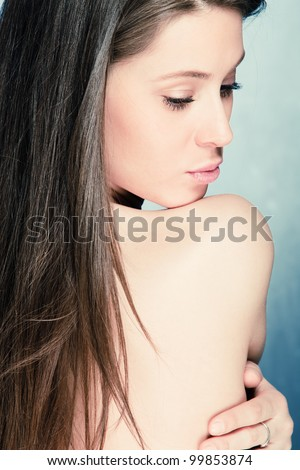 natural beauty portrait of young brunette woman back view - stock photo