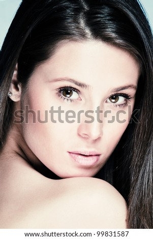 natural beauty portrait of young brunette woman studio shot