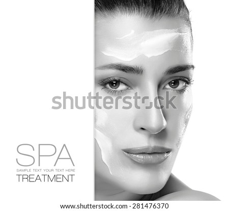 Natural Beauty. Spa treatment and skin care concept. Portrait of a gorgeous woman with cosmetic cream on her cheeks and forehead and blank copy space alongside with sample text. Template design - stock photo