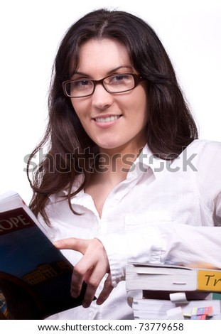 natural beauty young woman reading travel books enjoys planning a trip; one of series of this model in portfolio