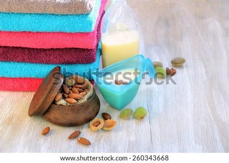 natural bio washing powder almond and a stack of bath towels - stock photo