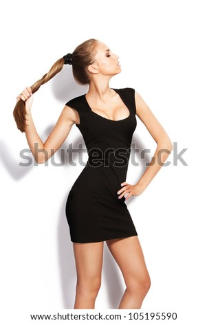 natural blond hair young woman pose in studio on white - stock photo
