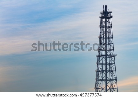Natural blue sky background over Oil refinery tower