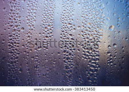 Natural blue water drops on the window. background