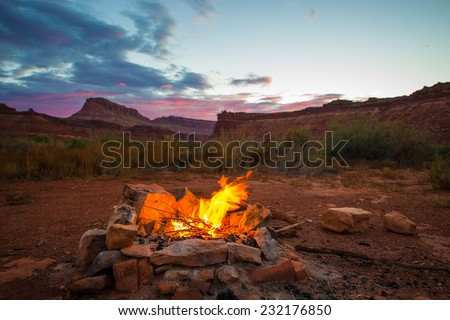 Natural bonfire on the bottom of the canyon after Sunset Utah Landscape - stock photo